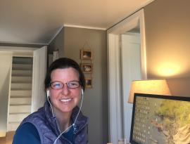 board member lynette potvin sitting at her computer at home