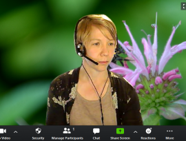 board member maria janowiak on zoom with big native plant virtual back ground!