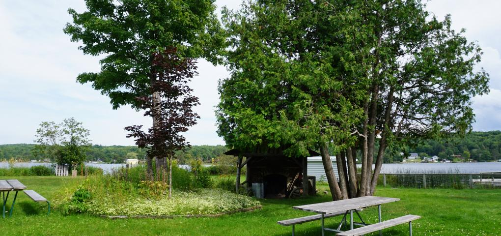 picnic table and expansive yard at Marsin with Portage Canal in background
